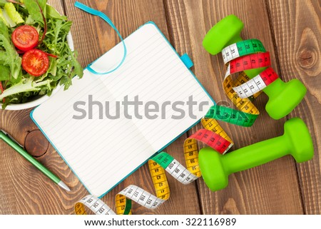 Dumbells, tape measure, healthy food and notepad for copy space. Fitness and health. Isolated on white background - stock photo