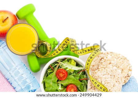 Dumbells, tape measure, healthy food and towels. Fitness and health. Isolated on white background - stock photo