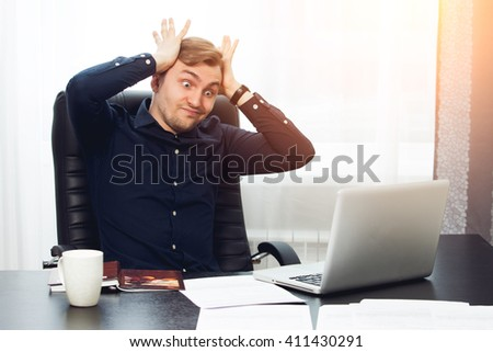 dumbfounded freelance worker forgot about deadline with expressive face - stock photo