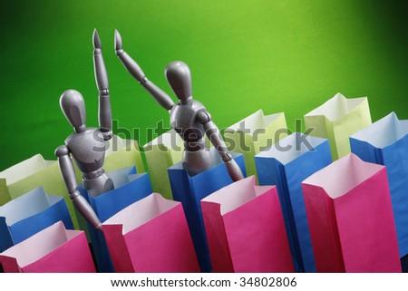 Dummies hi five over paper bags - stock photo