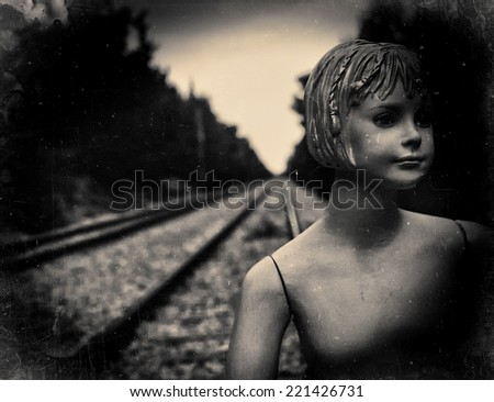 Dummy on railway tracks. Film scan filtered and processed with vintage effect - stock photo