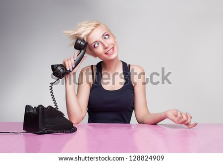 dummy secretary with punk style hair trying to answer the phone - stock photo