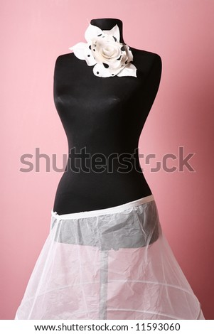 Dummy with flower and dress in the shop - stock photo