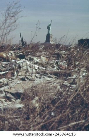 Dump in New Jersey with a view of the back of the Statue of Liberty in New York Harbor. This landfill was developed into Liberty State Park which opened June 14 1976. Ca. 1973-75. - stock photo