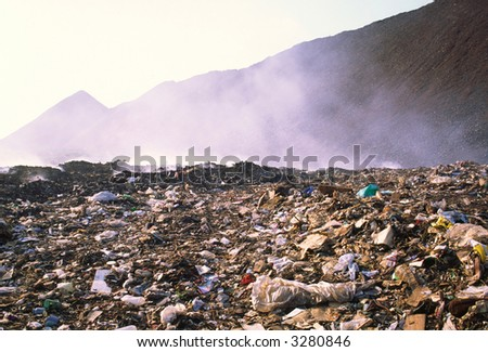 Dump of dust and allocated gases from burnt waste products - stock photo