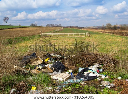 Dump of garbage in countryside - stock photo