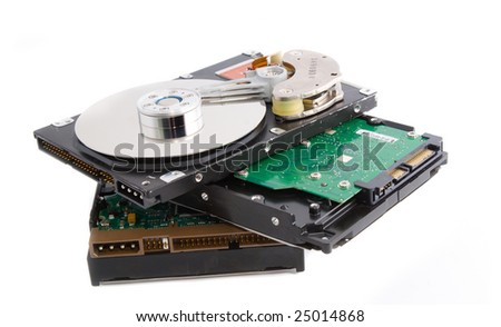 Dump of information: stack of hard drives (hdd) - stock photo