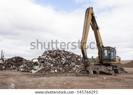 Dump of scrap for recycling in steel making plan. - stock photo