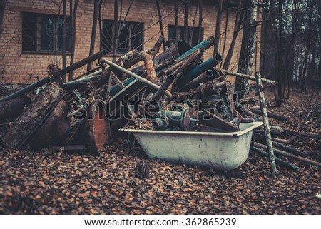 Dump the street from the old bathroom pipes and piles of devastation in the exclusion zone in detail, Chernobyl, Pripyat