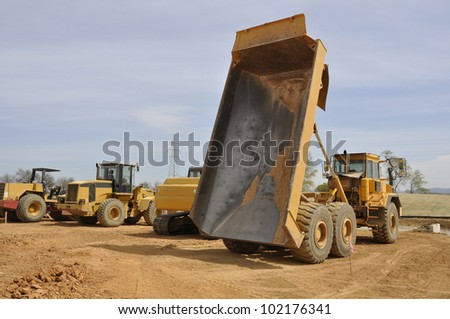 dump truck, a type of construction vehicle used in excavation - stock photo
