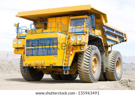 Dump truck, 220 tons, intended for transportation of rocks in mining conditions of deep pits - stock photo
