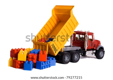 Dump truck toy downloading colorful blocks isolated on white - stock photo
