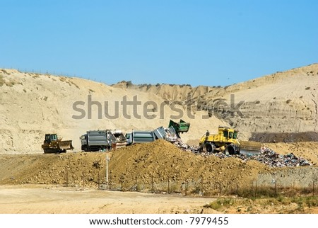 dumping of urban garbage with truck - stock photo