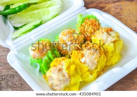 dumpling dim sum green yellow shumai Chinese Steamed Dumpling  - stock photo