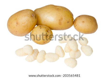 Dumplings and potatoes on white background - stock photo