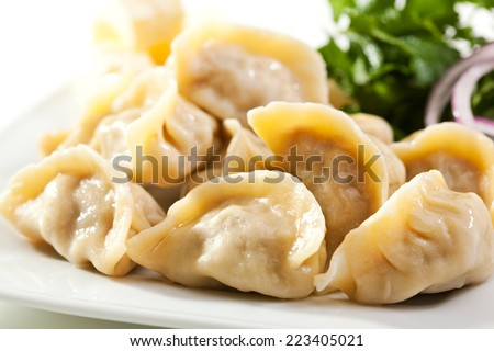 Dumplings Bowl with Onion and Butter - stock photo