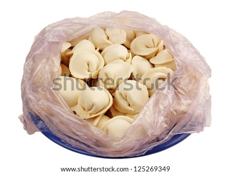 dumplings in clear plastic bag on a blue plate, isolated white background. - stock photo