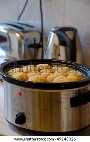 Dumplings in slow cooker with copy space.