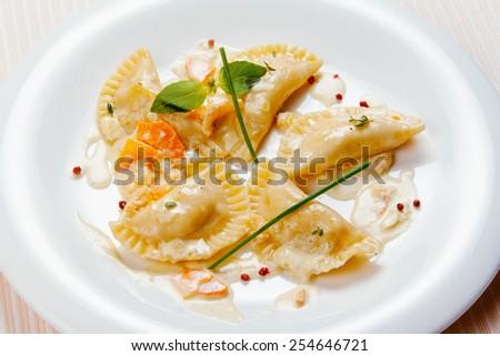 Dumplings on a white plate - stock photo