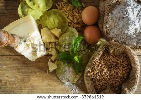 Dumplings , ravioli with cheese, basil and pine nuts, pesto. Pasta with integral flour. - stock photo