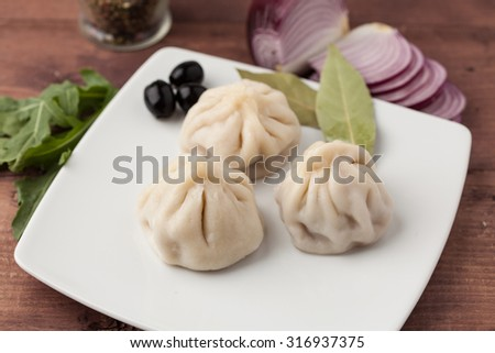 Dumplings - russian pelmeni - italian ravioli - on plate  - stock photo