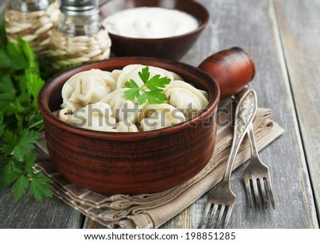 Dumplings with meat.  Pelmeni russian national dish - stock photo