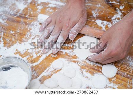 Dumplings Working - stock photo