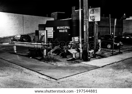 Dumpster in a parking lot at night in Hanover, Pennsylvania. - stock photo