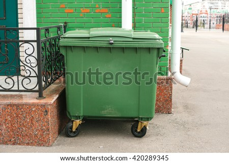Dumpster next to the house. Ecological concept. - stock photo