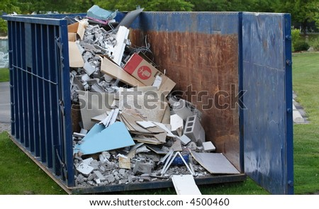Dumpster with construction debris - stock photo