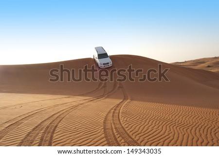 Dune riding in arabian desert - stock photo