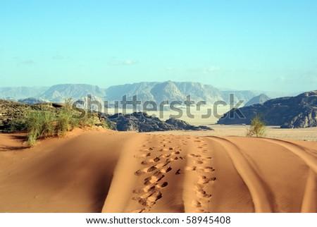 Dune, track and footprints in Wadi Rum desert - stock photo