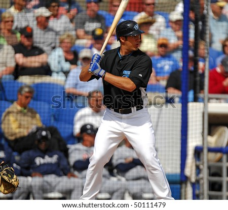 DUNEDIN, FL - MARCH 22: Toronto BLue Jays catcher J.P. Arenciba stands in the batters box ready for the pitch in the March 22, 2010 spring training game in Dunedin, FL - stock photo