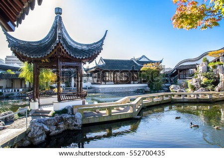 Dunedin,New Zealand - May 3,2016 : Zigzag bridge is one of the important elements of The Dunedin Chinese Garden design.It can connecting the Heart of the Lake Pavilion and the rock mountain.
