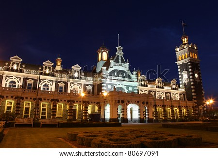 Dunedin's famous historic railway station at nightime. - Dunedin New Zealand. This ornate Flemish Renaissance-style building was opened in 1906 and is a famous landmark in the University city.