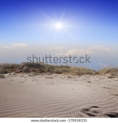 Dunes and sand dunes on a blue sky background - stock photo