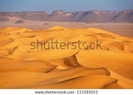 Dunes in the Sahara desert - stock photo
