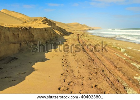 Dunes of Sandwich Harbour, Walvis Bay, is a part of the Namib Naukluft Park Namibia. Wild and remote area accessible only by off-road. - stock photo