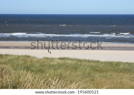 Dunes with sea waves and blue sky