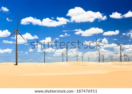 Dunes with Wind turbines generating electricity - stock photo