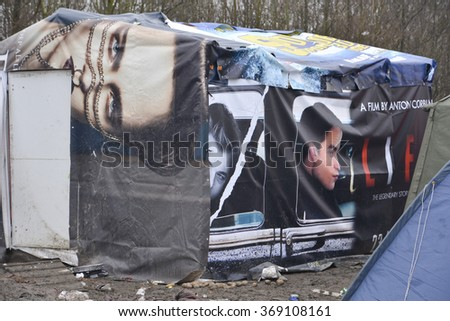 Dunkerque, France-23 January 2016: Tent made from billboard pastic. Refugee camp Grande-Synthe in France is a muddy camp with a lot of dirty waste. People are cold and hungry.