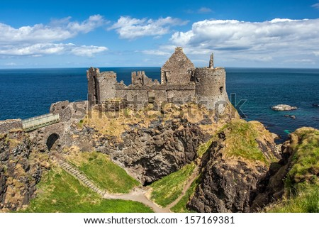 Dunluce Castle, Northern Ireland, at the edge of a cliff - stock photo