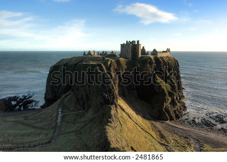 Dunnottar Castle near Aberdeen Scotland, photographed on a winter morning. - stock photo