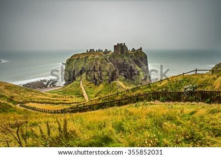 Dunnottar Castle, Scotland, United Kingdom. Long exposure. - stock photo
