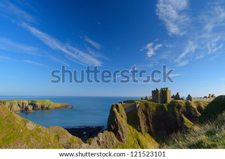 Dunnottar Castle  with blue sky background in Aberdeen, Scotland. - stock photo
