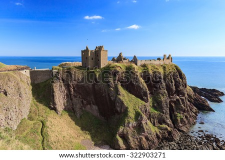 Dunnottar Castle with blue sky in - Stonehaven, Aberdeen, Scotland UK - stock photo