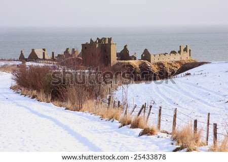 Dunnottar Castle with snow on the ground, Scotland - stock photo