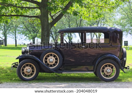 DUNNVILLE - JUNE 29: A 1930 Ford model A parked near lake Erie in Dunnville, Ontario, Canada in June 29, 2014.  - stock photo