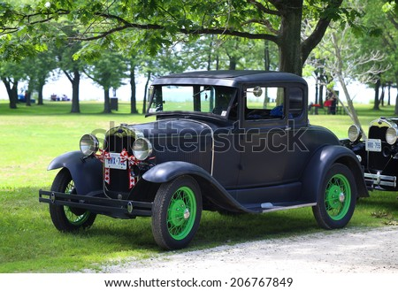 DUNNVILLE - JUNE 29: A 1930 Ford model A parked near lake Erie in Dunnville, Ontario, Canada in June 29, 2014.