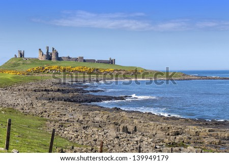 Dunstanburgh castle near Craster in Northumberland,England - stock photo